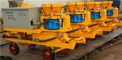 Wet shotcrete machine with rail wheels