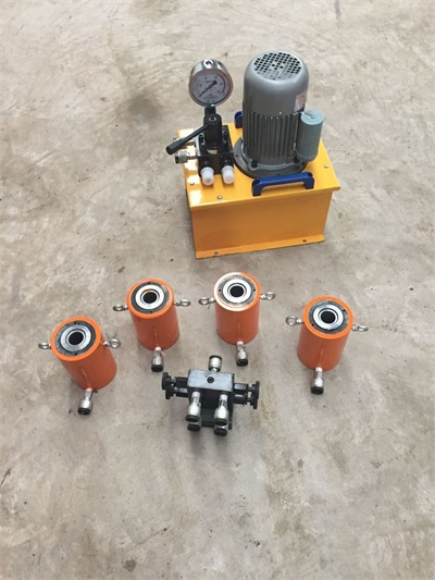 One pump with four single acting hollow hydraulic jack